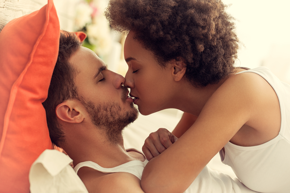 Black woman white man kiss during sex