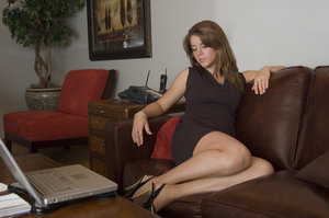 Hot black girl on leather couch