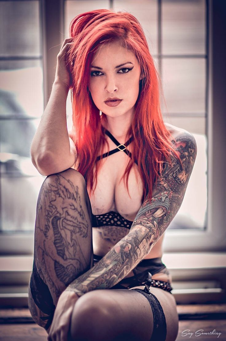 Captions redhead with tattoos