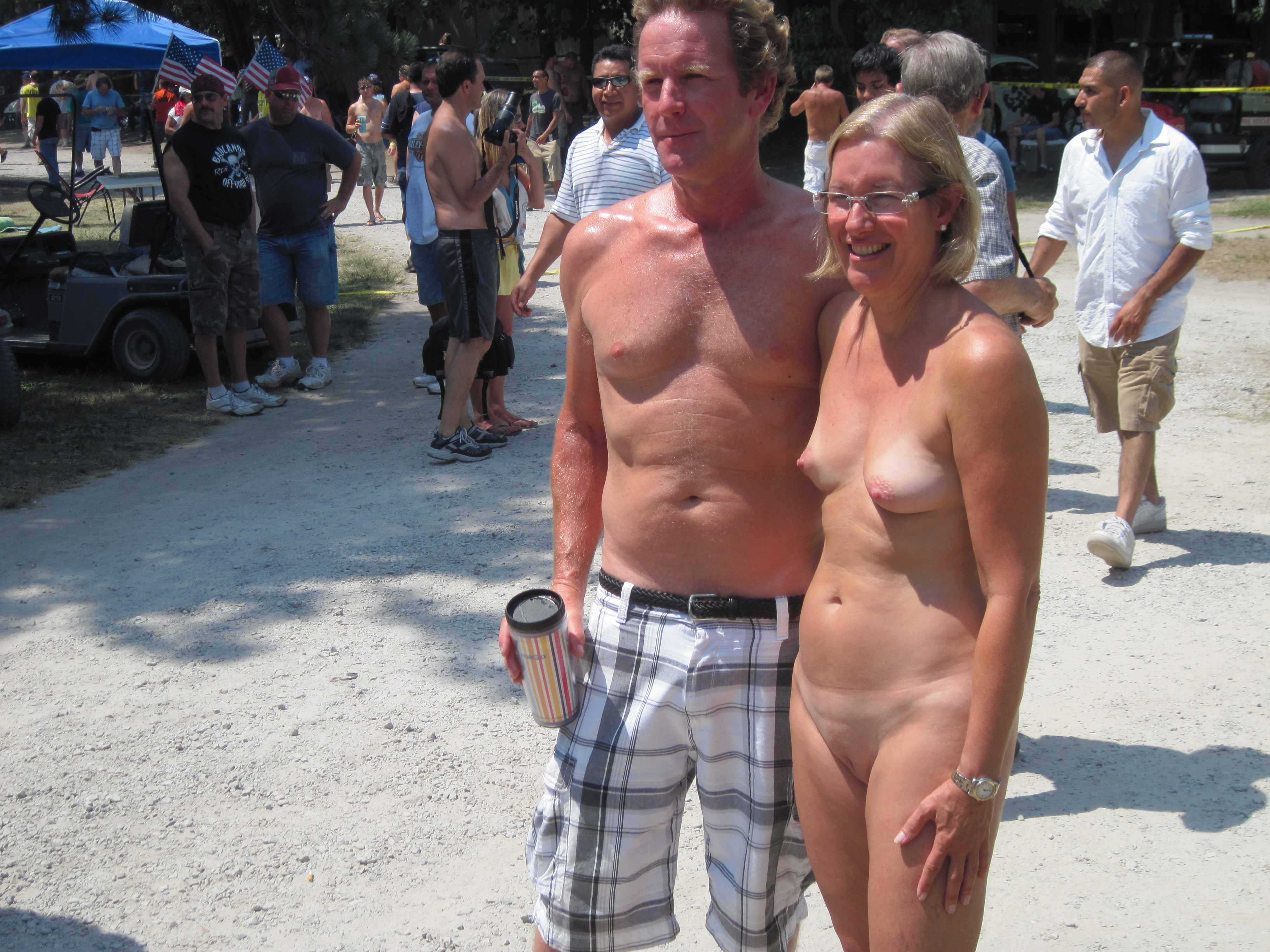 Looking at naked man clothed women