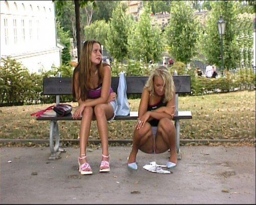 Girls peeing outside