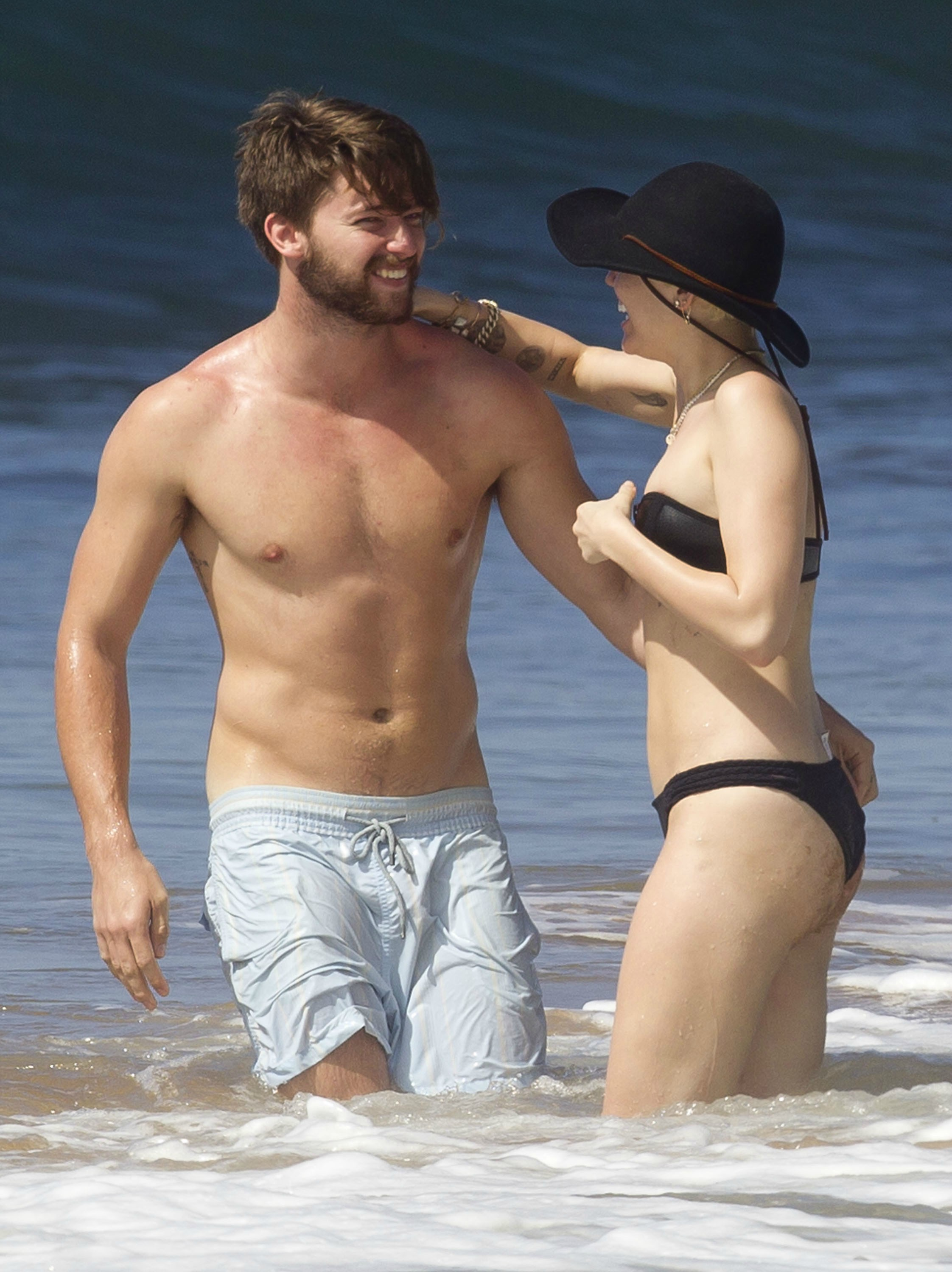 Miley cyrus topless beach