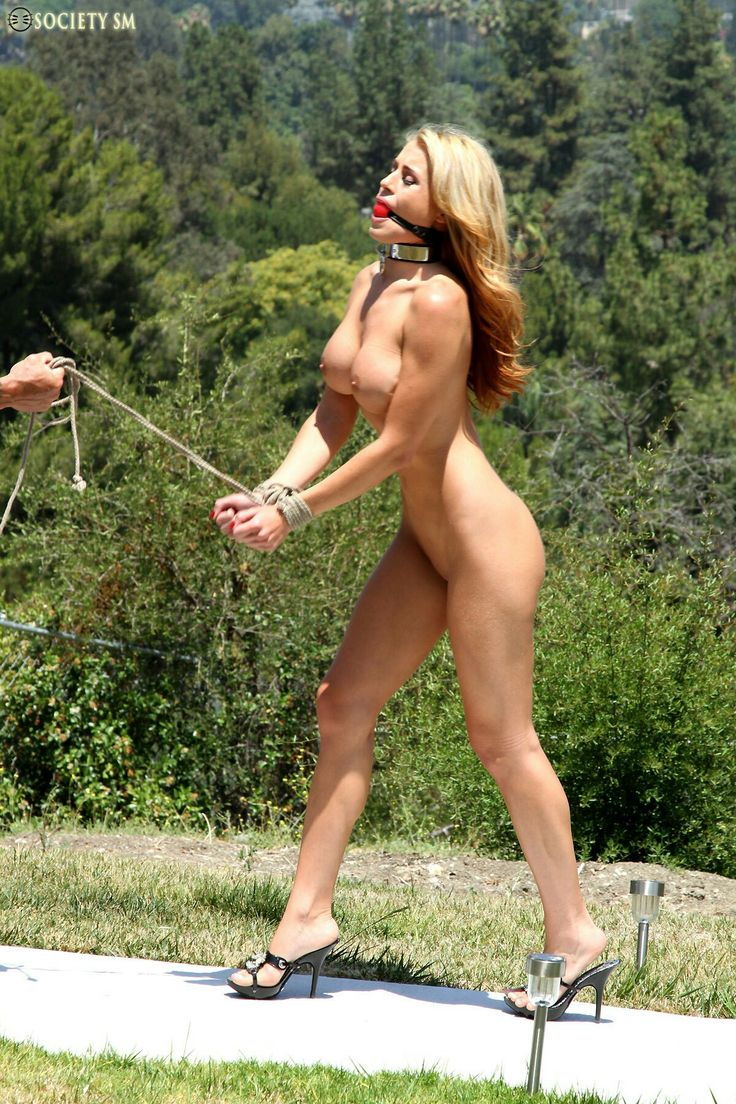 Nude women outdoors bondage