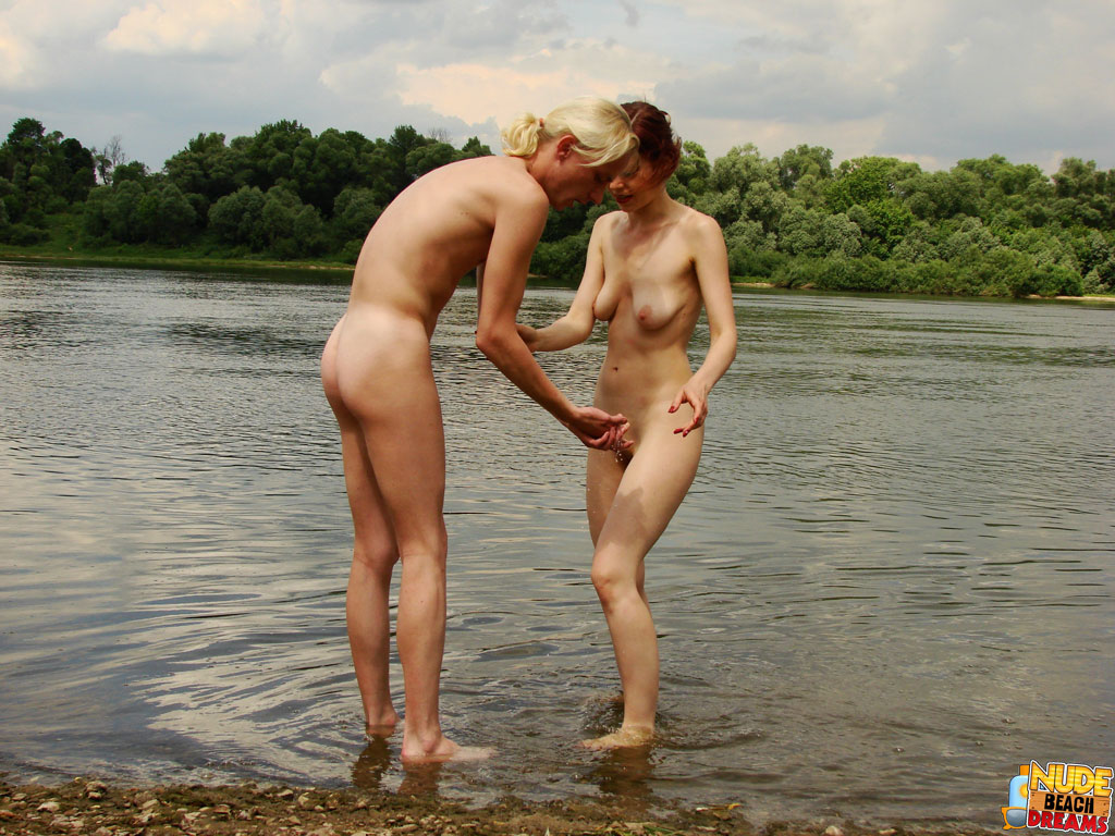 Naked couples on the beach having sex