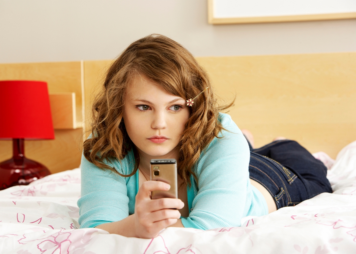 Young teen girl with phones