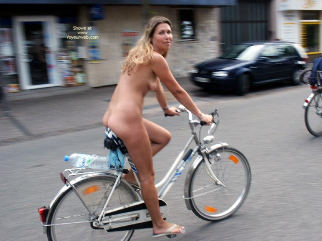 Sexy nude girls on bicycles