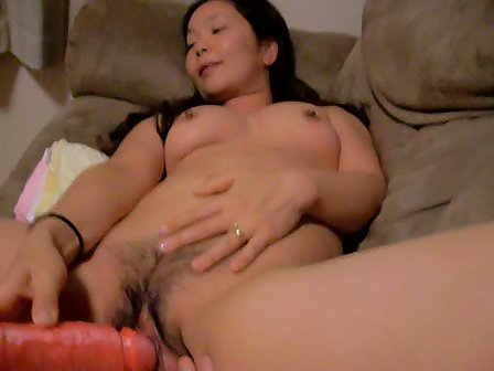 Naked asian girl fucking herself