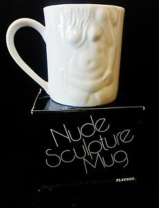 Nude woman with coffee cup
