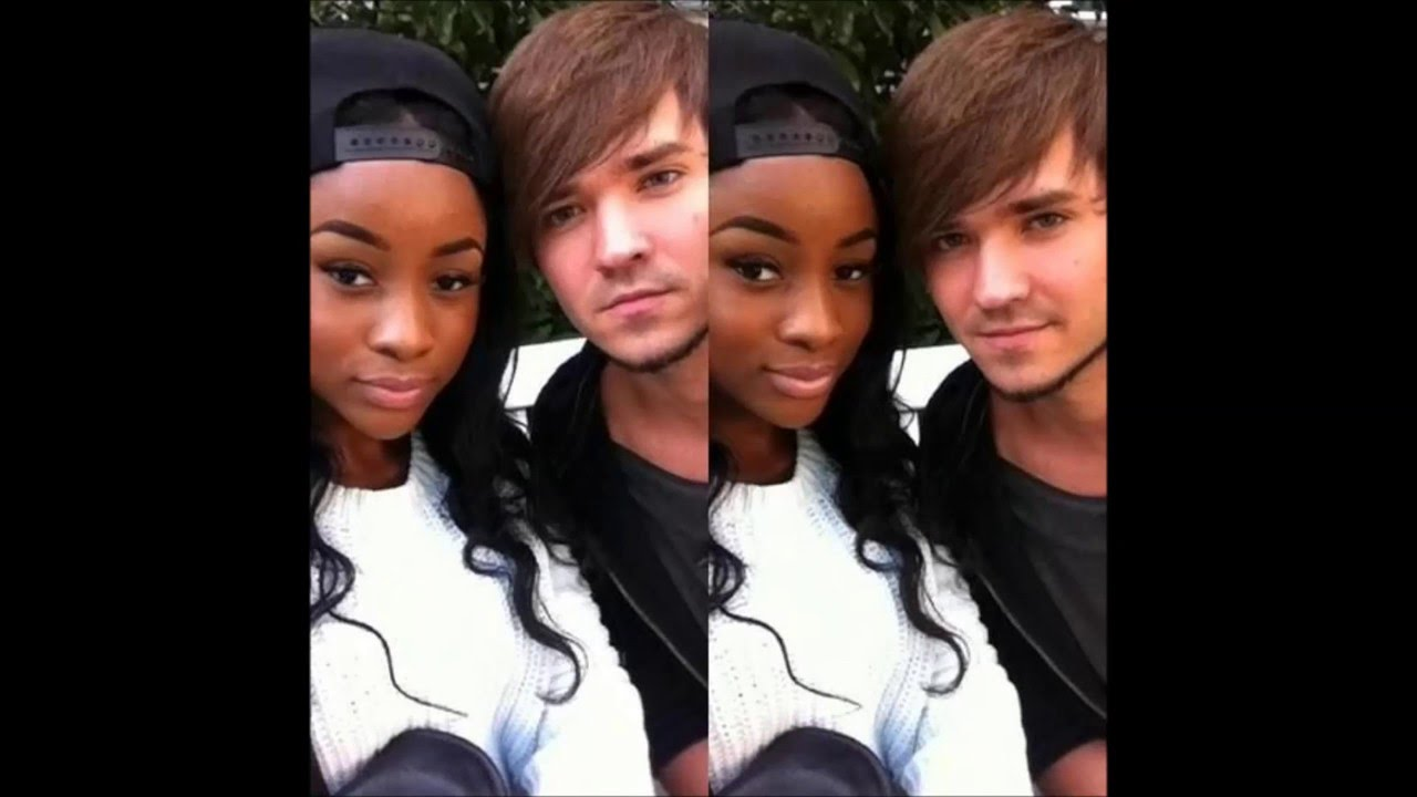 Black couple white girl and boy