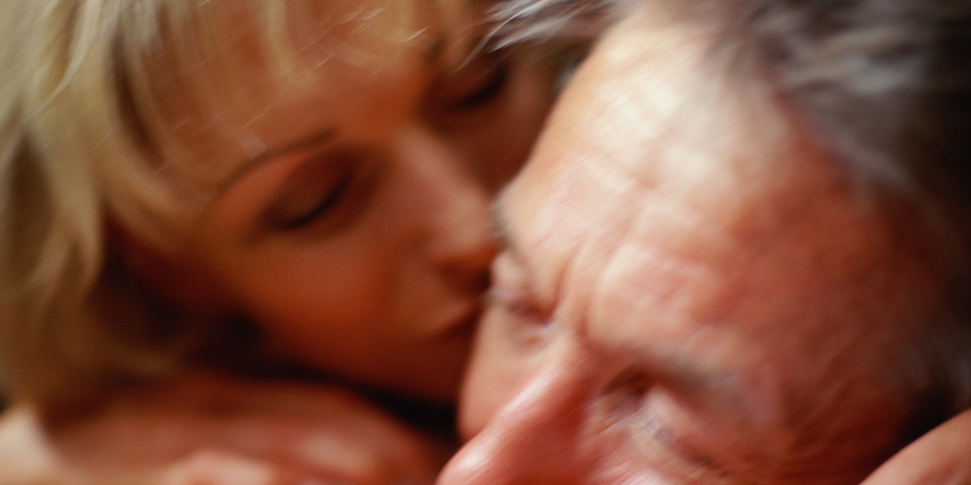 Mature couples making love