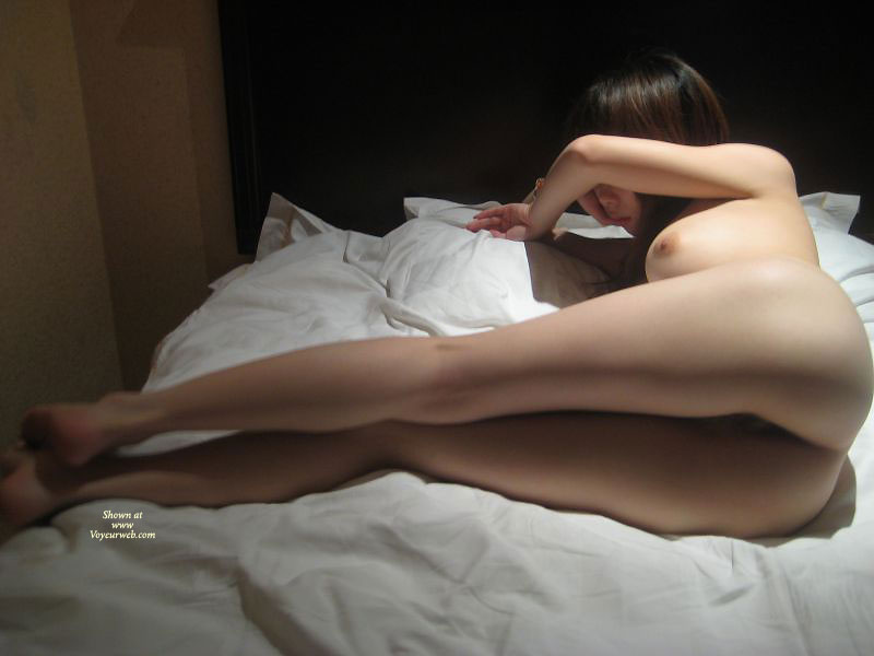 Asian girl naked on bed