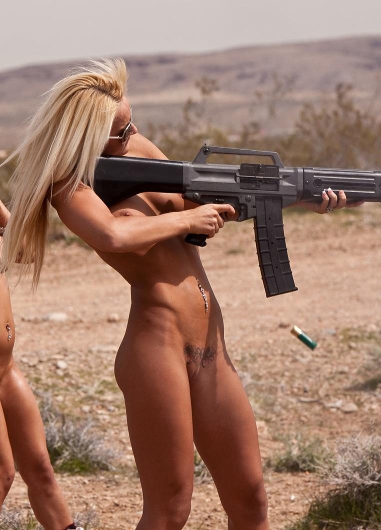 Naked women shooting guns