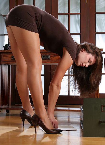 Women in dresses bending over