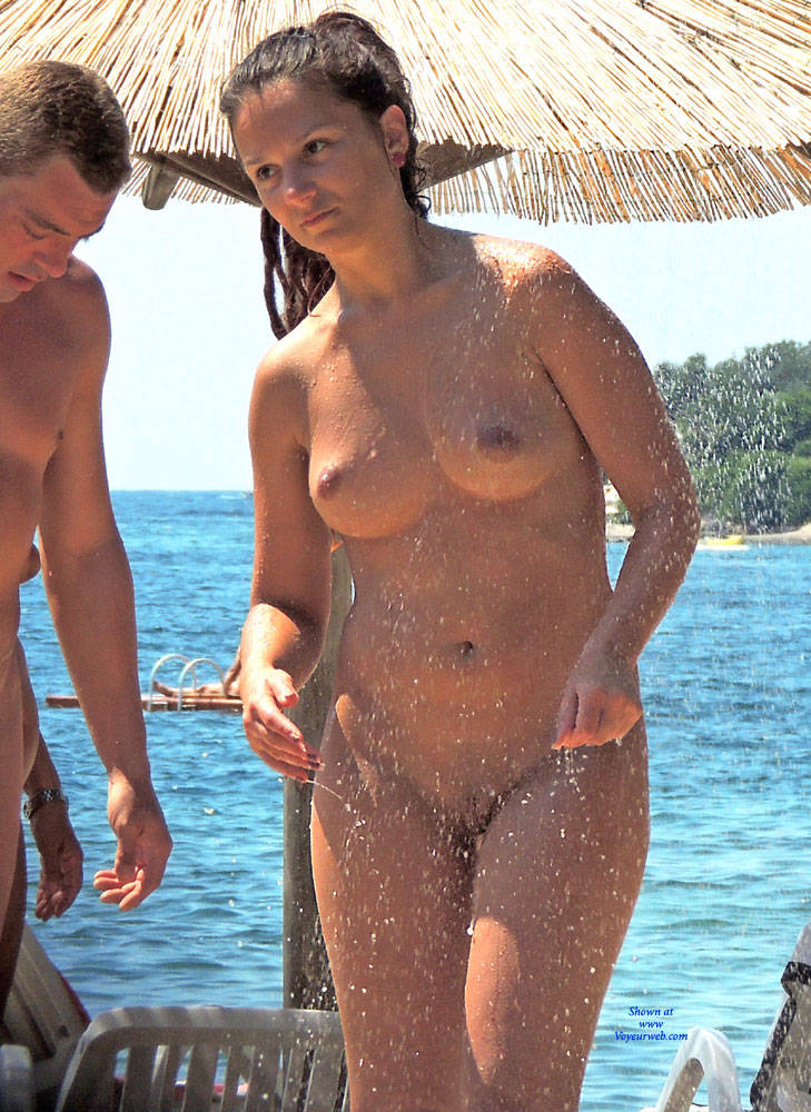 Family nudist beach shower