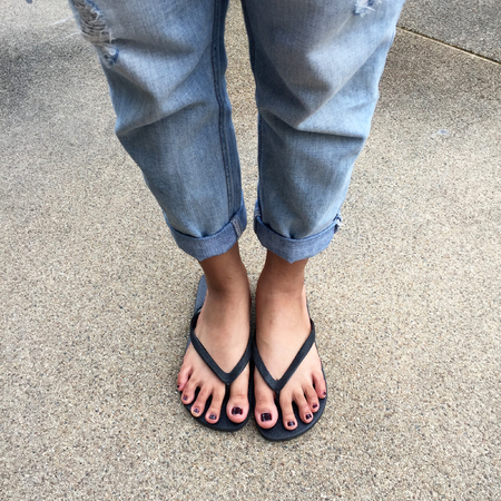 Black girl feet in sandals
