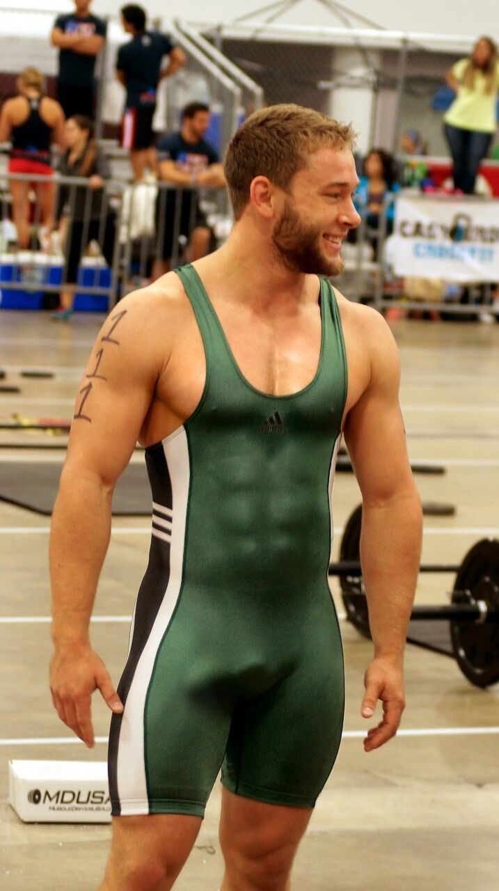 Male wrestler in singlets with boners