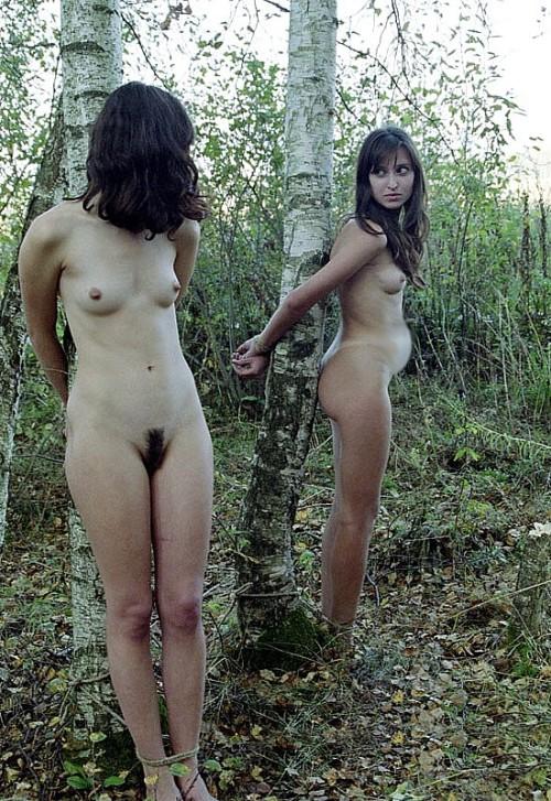 Nude women outdoors bondage