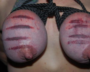 Purple tit torture bdsm