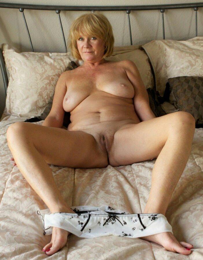 Naked granny spreading