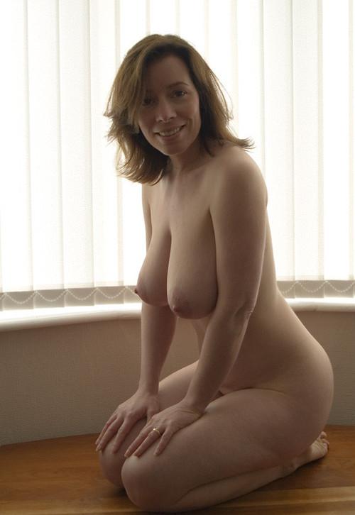 Nude wife on her knees