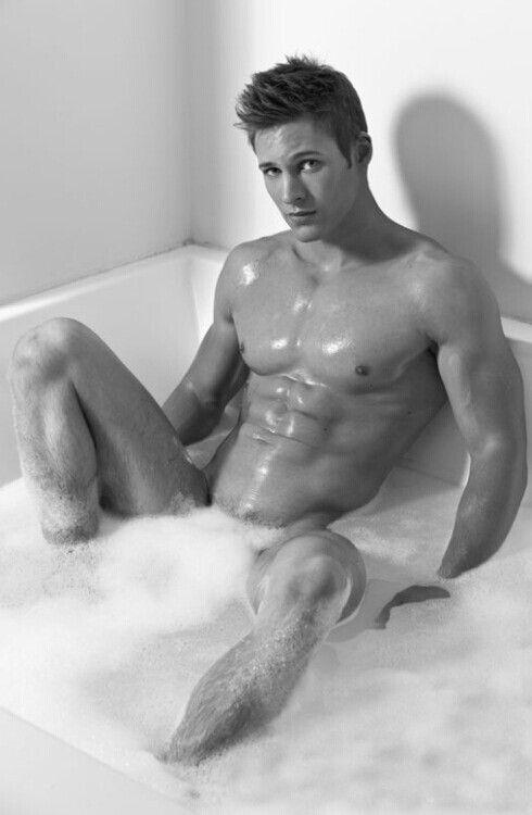Nude boy bath time