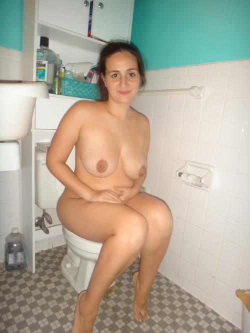Nude girls sitting on toilet