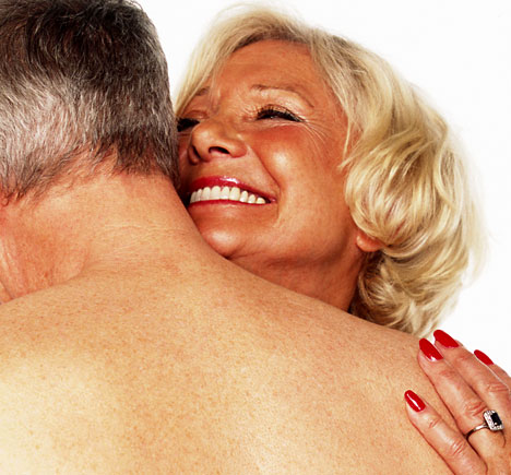 Mature men and women making love