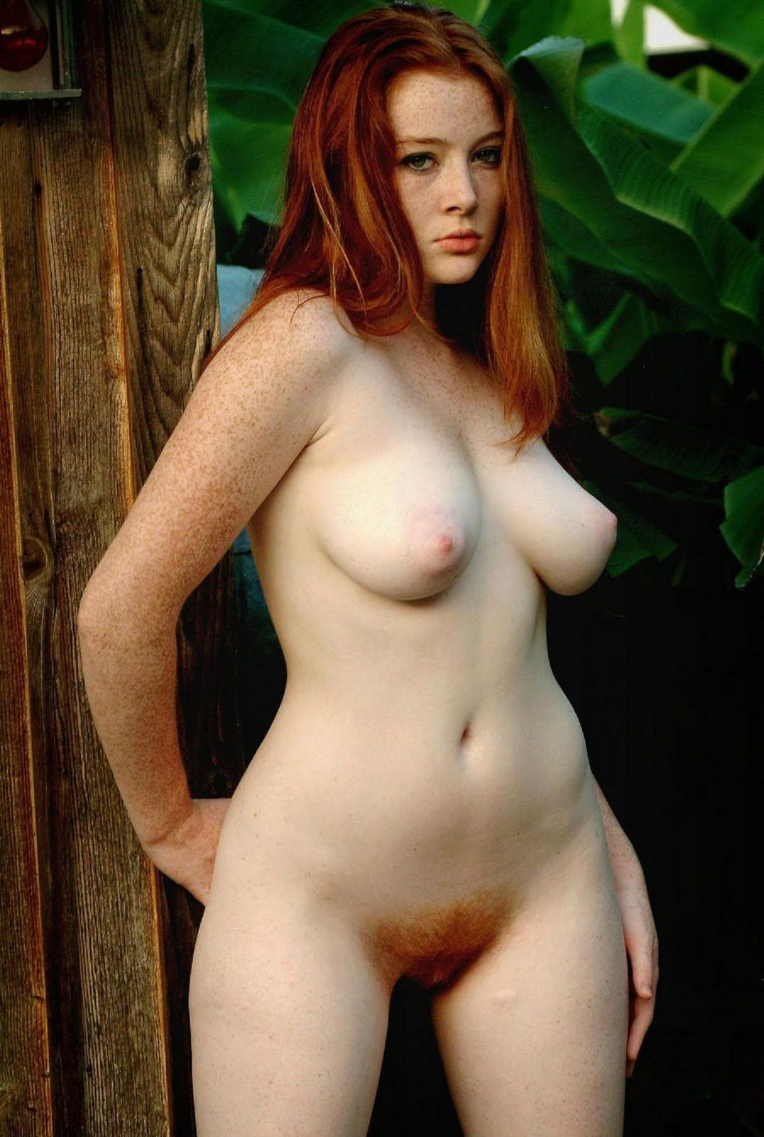 Nude freckled redhead with hairy pussy