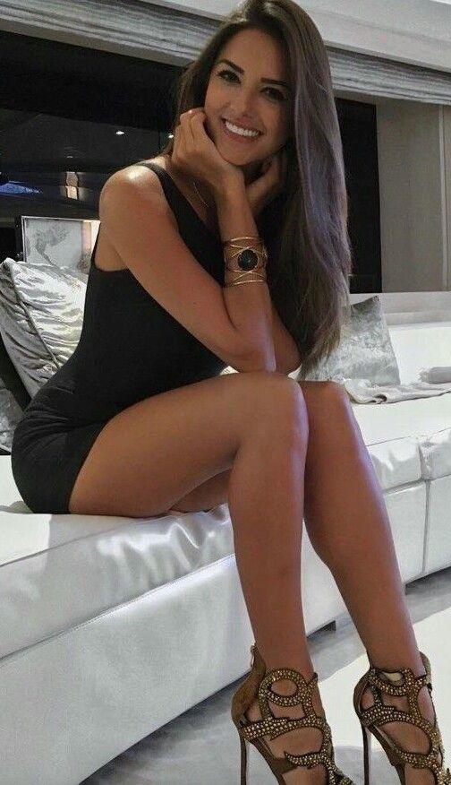 Beautiful women legs mini skirts