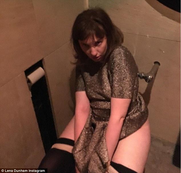 Mom sitting on toilet
