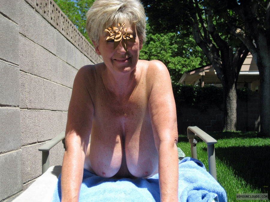 sunbathing Mature big outdoors tits
